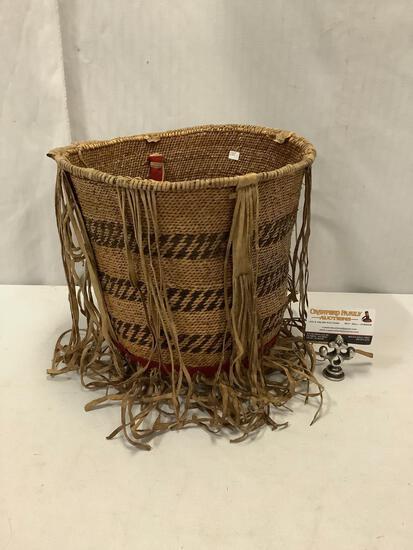 Navajo basket w/ decorative leather straps. Approx 12x12x12 inches.