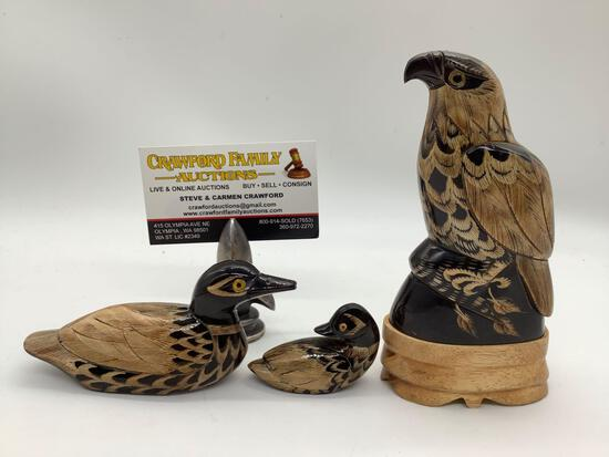 Lot of 3 hand carved buffalo horn scrimshaw bird figures. Ducks and falcon. Largest approx 6x3x2 in.