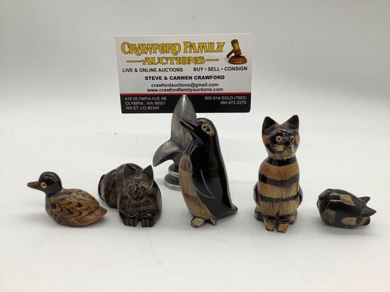 5x hand carved buffalo horn scrimshaw animal figures. Pig, penguin, cats, and duck. approx 2x3 inch