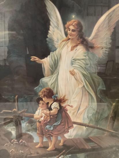 Framed print of angel with children.