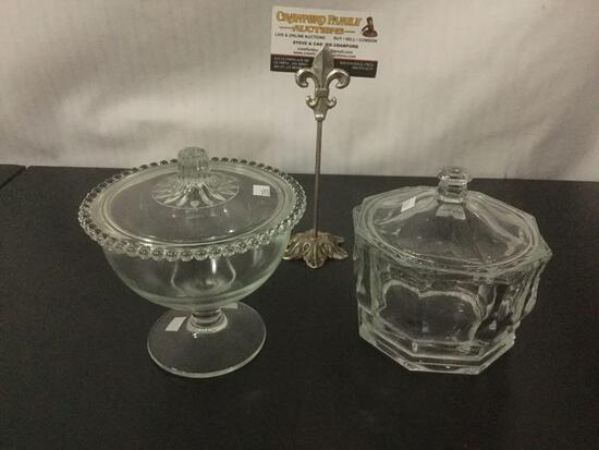 2 glass lidded candy dishes, incl. 1 w/ beaded rim glass lid & 1 thicker glass piece.