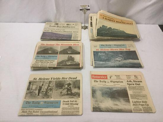 20 vintage 1980 newspapers covering Mt. Saint Helens eruption: Seattle Post, Daily Olympian, & more.