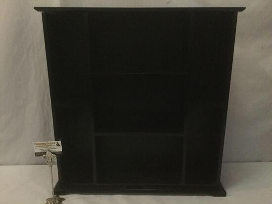 Small black wooden shelf w/ 7 cubbies, top is somewhat loose, approx. 25x25x6 inches.