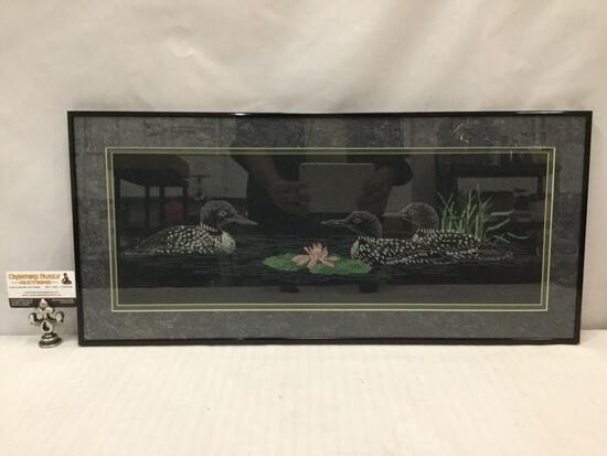 Framed cross stitched loon artwork, professionally framed