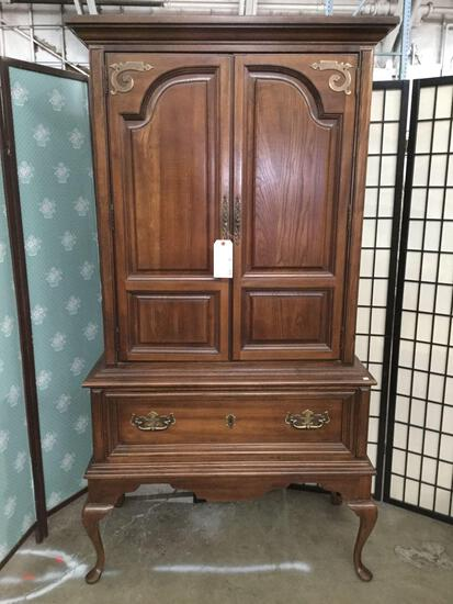 Vintage carved oak 4-drawer armoire on cabriole legs w/ brass pulls, approx 19x38x74 in