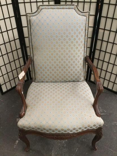 Vintage upholstered arm chair w/ cabriole legs, shapely arm rests, & carved floral designs