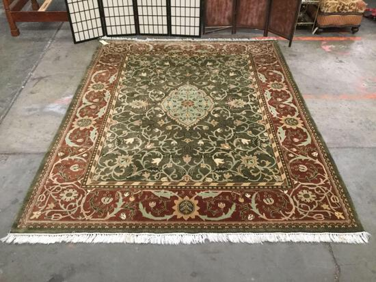 Earth tone rug w/ floral designs & fringe, approx 99x122 inches. See pics for condition.