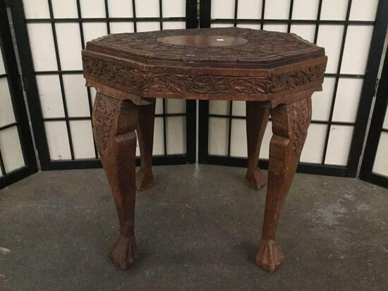 Small vintage carved wood claw foot table with floral wood cut design