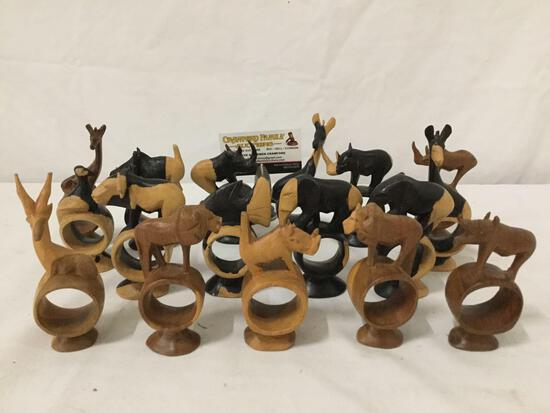 Large lot of African wood carved wildlife/animal design napkin rings.