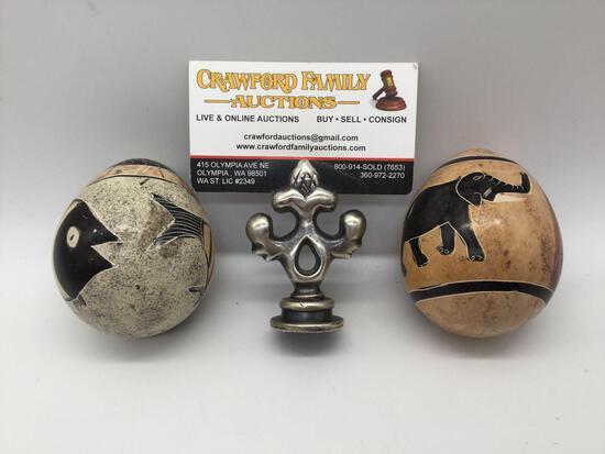 2x decorative egg art pieces; 1 w/ fish designs and 1 w/ rhino & elephant
