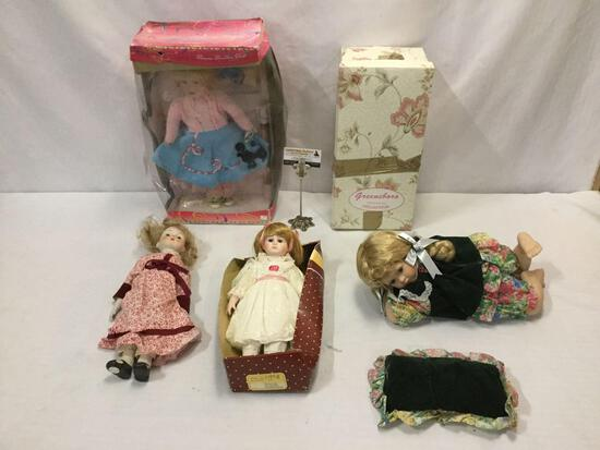 4 dolls; 1999 Brass Key Inc. porcelain doll, Greensboro and more
