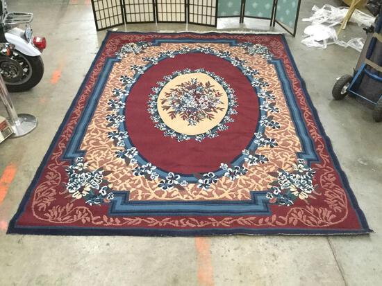 Beaulieu Rugs 100% olefin pile area rug w/ floral designs & worn fringe, shows wear