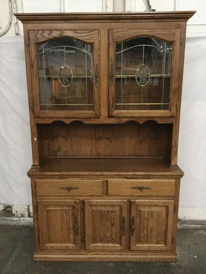 Modern oak 2 pc hutch cabinet with leaded glass door top and slight floral design