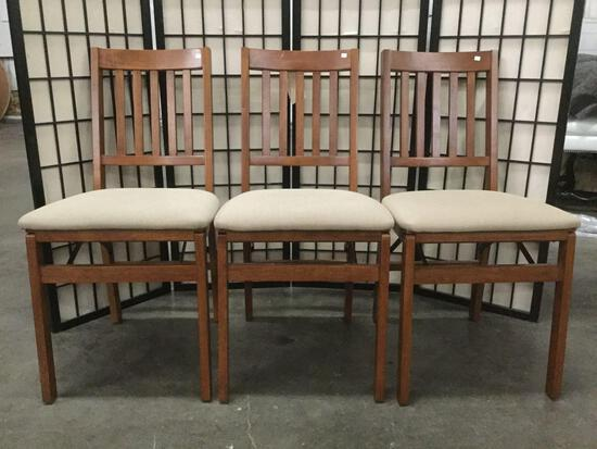 3 STAKMORE wooden folding chairs w/ beige upholstery