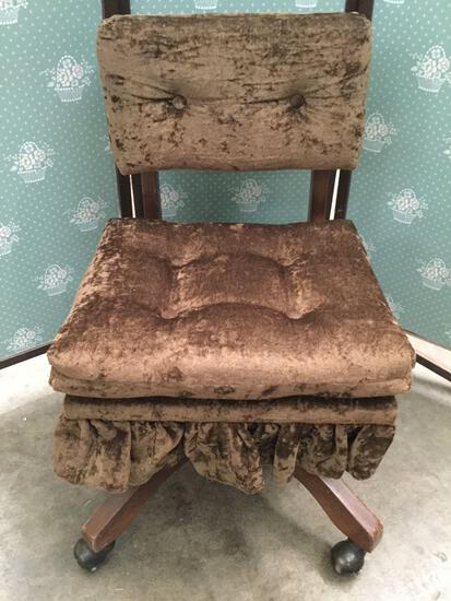 Vintage rolling office chair with velour style upholstery