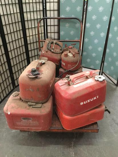 Collection of vintage gas tanks: Suzuki, Johnson, Mercury and more