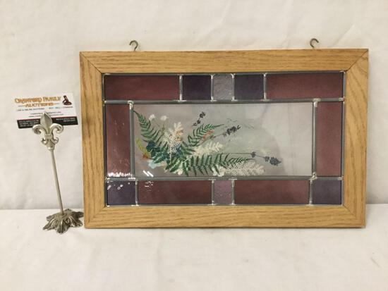 Framed stained glass with pressed flowers window display