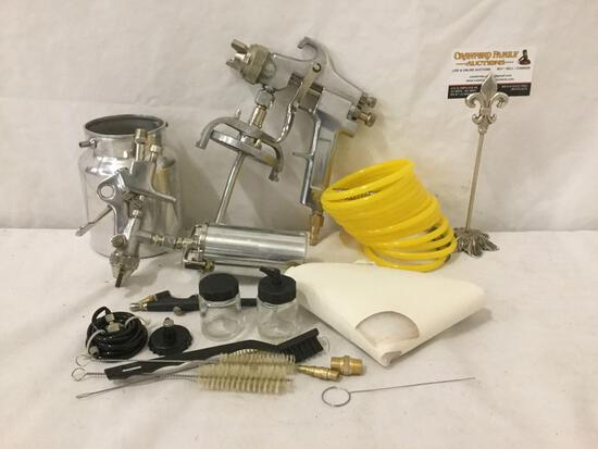 Airbrush lot; gun, hose, and paint canisters
