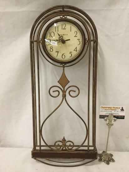 Howard Miller 625-295 wall clock, as is. Approx 22x9.5x2 inches