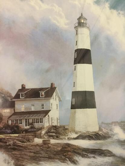 Framed lighthouse print. Approx 22x19 inches.