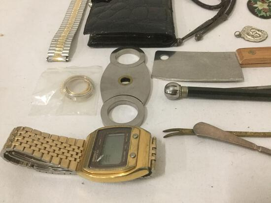 Large bag of mixed items: pocket knife, belt buckles, watches, sun dial & more