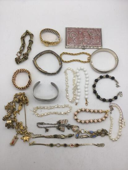 Lot of nice assorted bracelets; cuff, charm bracelet, business card holder case, pearl necklace &