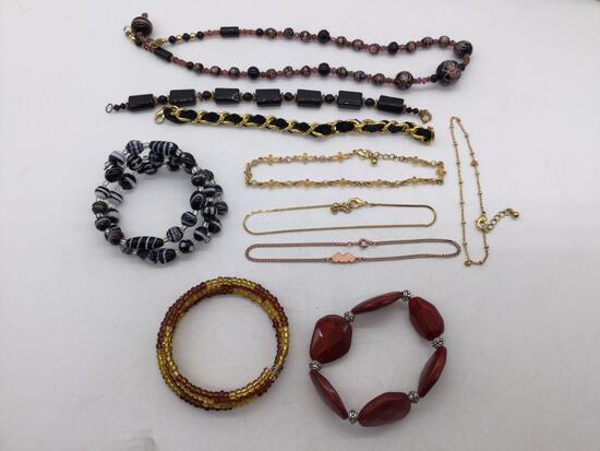 Estate jewelry: black bracelets, glass bead necklace, 4 ankle bracelets and more