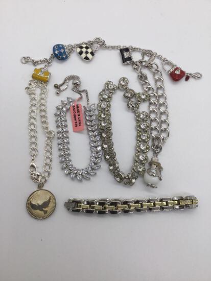 Lot of charm bracelets and estate jewelry bracelet.