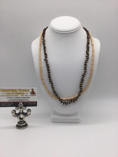 Two unique necklaces, incl. a 70s melon shell Hishi necklace & a stone bead necklace.