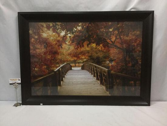 Framed bridge photo print in autumn colors, approx. 41x30x1 inches.