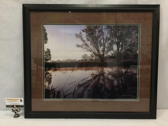 Framed trees reflected in pond photograph signed by Dale Fishel