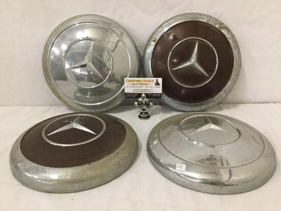 Collection of 4 vintage Mercedes hubcaps