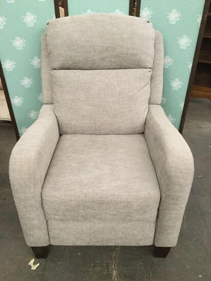 Modern slate gray cushioned armchair with clean design