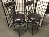 2 modern swiveling bar stools