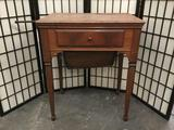 Vintage maple sewing cabinet with no machine and worn top - as is