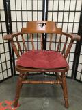 Wooden chair w/ armrests & red seat cushion, shows some wear, see pics. Approx. 31x25x20 inches.