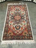 Vintage plush wool small rug with fiery red and cream design