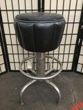 Shop stool w/ black upholstered seat & metal base