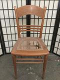 Vintage maple dining chair with unique back and torn cane seat