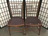 Pair of antique leather seat dining chairs circa early 1900s - as is