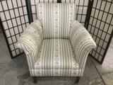 Modern upholstered deep seat armchair with sloped arms and fun pattern