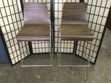 Pair of modern wood grain bar stools w/ backrest and chrome stands, approx. 42x20x20 inches each.