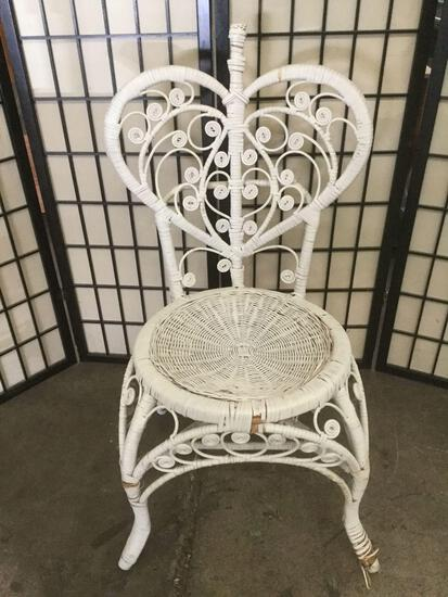 Woven wicker chair with heart shaped back, shows wear, sold as is
