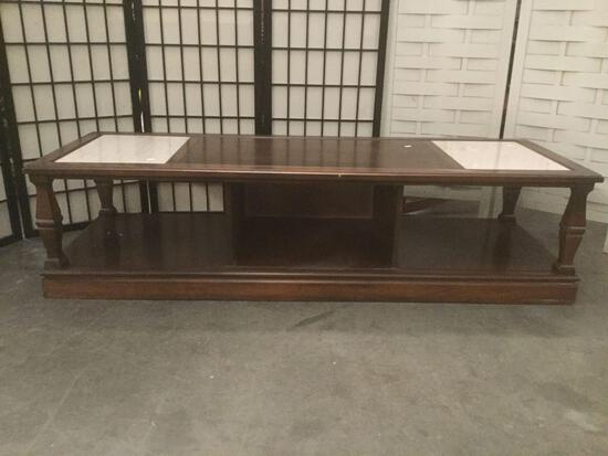 Wood coffee table w/two inlaid slabs of granite. Approx. 59x21x15 inches....