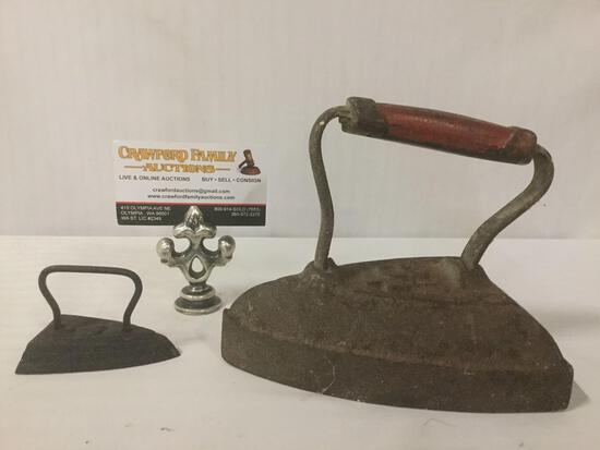 2 vintage/antique clothing irons, 1 marked No. 6, largest approx. 7x5x6 inches.