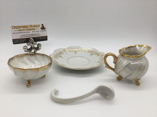 4 Japanese China items: saucer w/ gold tone trim, soup spoon, & opalescent creamer & sugar bowl.