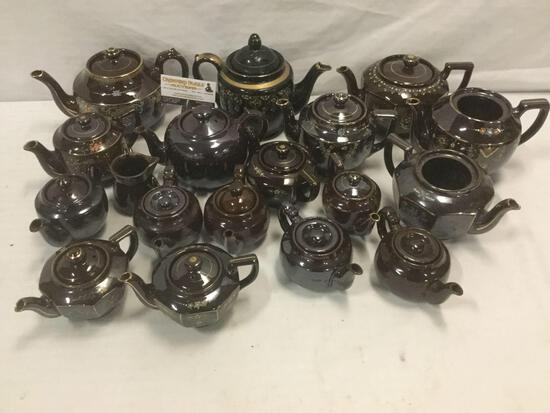 Huge collection of vintage brown ceramic tea pots w/ decorative designs, marked: made in Occupied in
