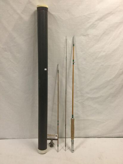 Vintage three-piece wood fly fishing pole in plastic travel case