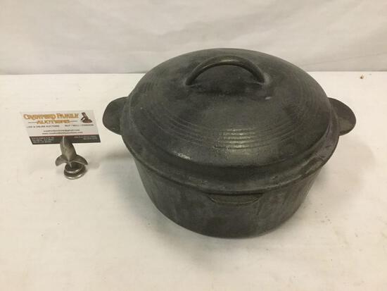 Vintage cast iron pot with lid.