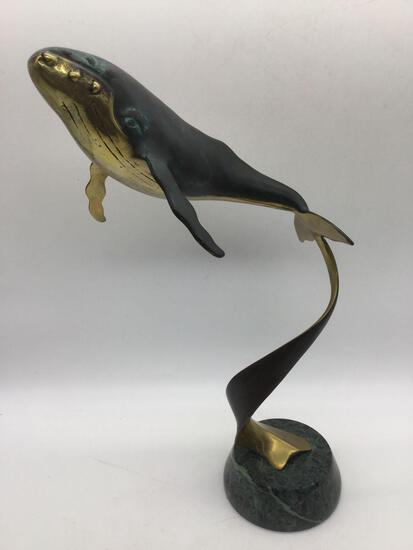 Vintage brass whale sculpture art piece on marble base